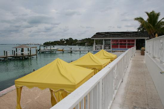 Romora Bay Resort & Marina: man made beach by the docks & view of Sunset Grille