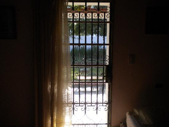 Hotel Boutique Tampu : fenced glass door to our room