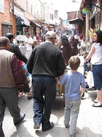 Riad ALAMANDA : Riad porter holding our son's hand tightly, whilst transporting our baggage through the medina!