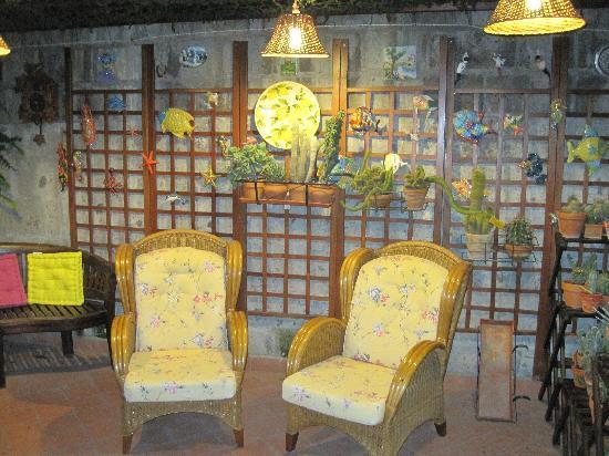 Orchid Corner B&B: Garden Patio Chairs at night.