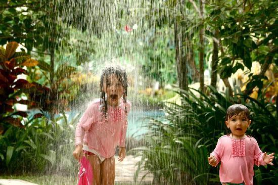 The Laguna, a Luxury Collection Resort & Spa: Our kids under the Laguna's rain shower