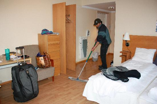 City Living Scholler Hotel & Apartments : The not so happy huz mopping up the mess