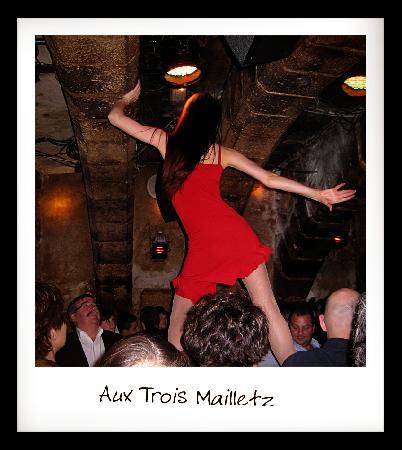 Aux Trois Mailletz: cabaret dancer on main table