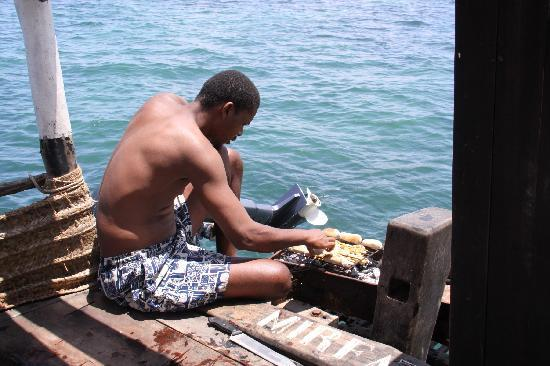 Lamu Island, Kenya: lunch being prepared on the dhow