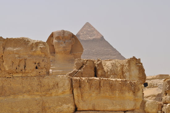 Cairo, Egypt: Sphinx with pyramid in background