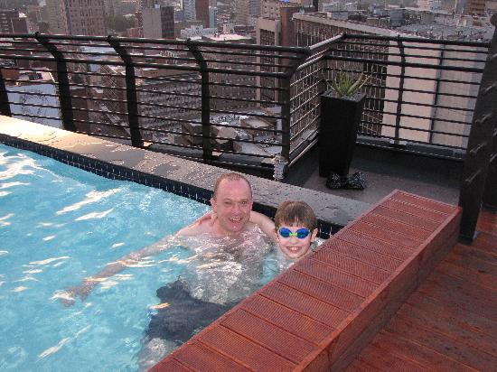 Braamfontein, South Africa: My son, Alasdair McKerrell, and I in the rooftop pool.