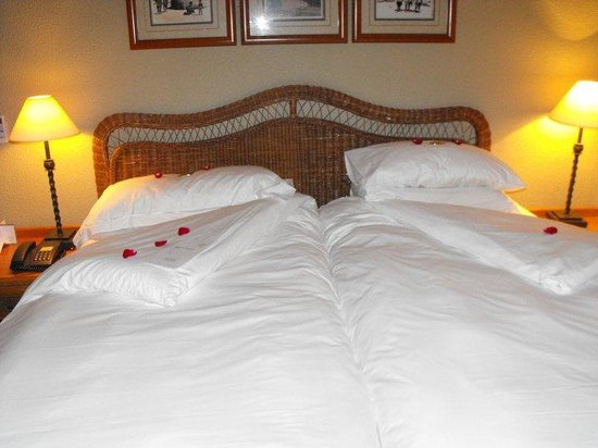 Ezulwini, Swaziland: A Welcoming bed, with rose petals and Chocolates on the pillows