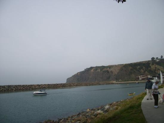 Dana Point Harbor: Cliff and break water inlet