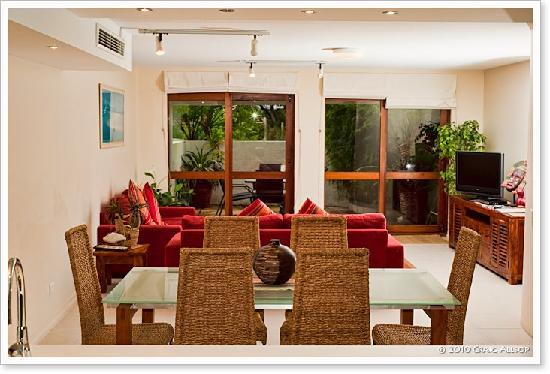 Camargue Beachfront Apartments Lounge TV Outdoor Setting