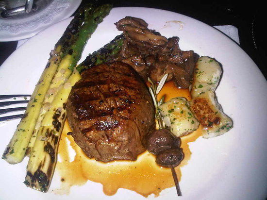 N9NE Steakhouse: filet Mignon with asparagus, sautéed mushrooms and onions and Gnocchi
