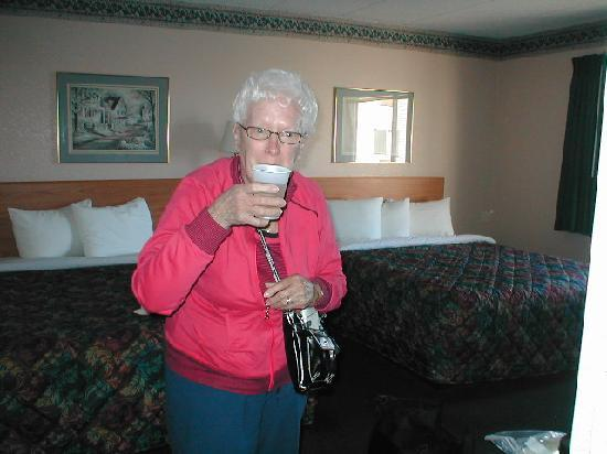 AmericInn Hotel & Suites Sheboygan: Mom enjoying a cup of wine with her room in the background