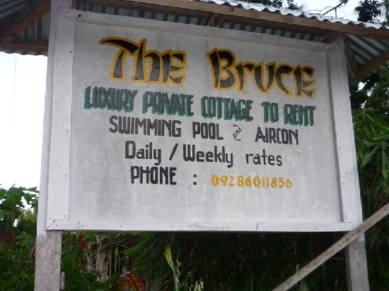The Bruce : Sign on the road with telephone number.