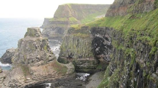 Ballycastle, UK: After a 4.5 mile hike up hills and across the Island, we got to see the beautiful cliffs where a