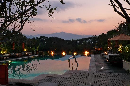 Four Seasons Resort Chiang Mai: Sunset over the resort's swimming pool.