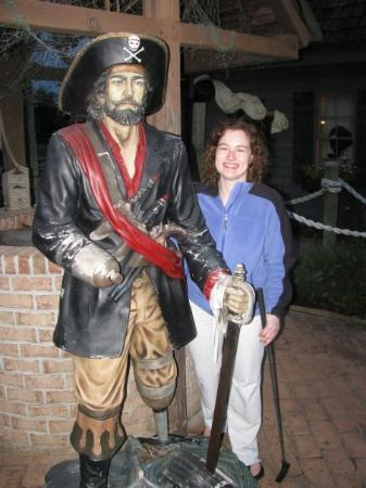 Pirate's Cove Adventure Golf : Katie and a pirate friend.  I feel bad that he doesn't even have a hook hand, and he also appear