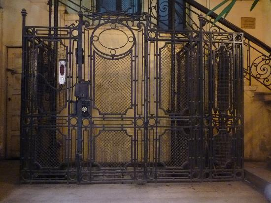 Stunning Wrought Iron Grillwork On The Elevator Step Back