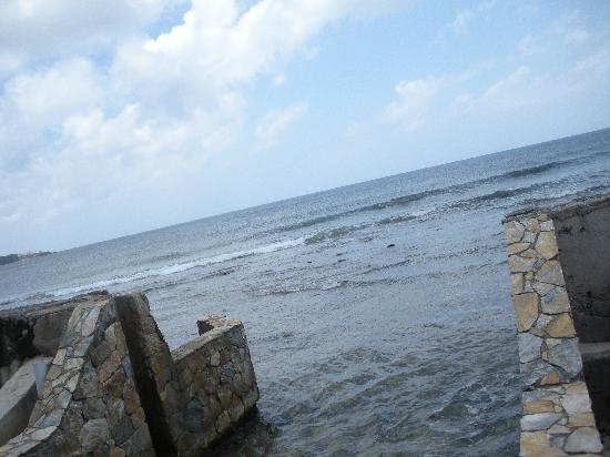 Parrot Tree Beach Resort: There is a big wall that seperates the beach lagoon from the actual water. Here is part of it.