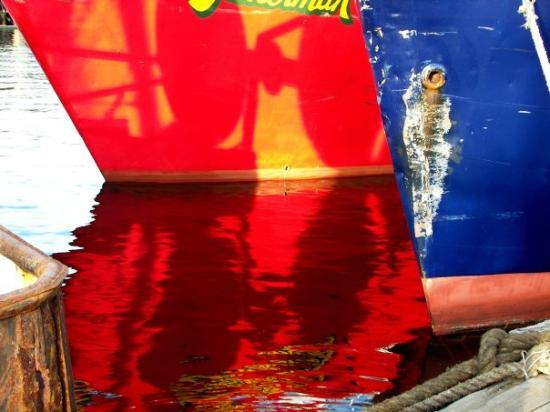 New Bedford, MA: Reflections of fishing boats painted in the bright colors of Portugal