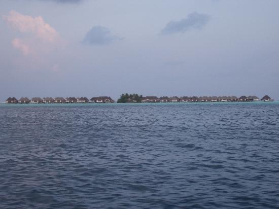 Four Seasons Resort Maldives at Kuda Huraa: A view of the Water Villas from at a distance.