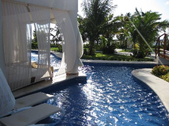 Lazy river and swim up room patio - Picture of El Dorado Maroma, by ...