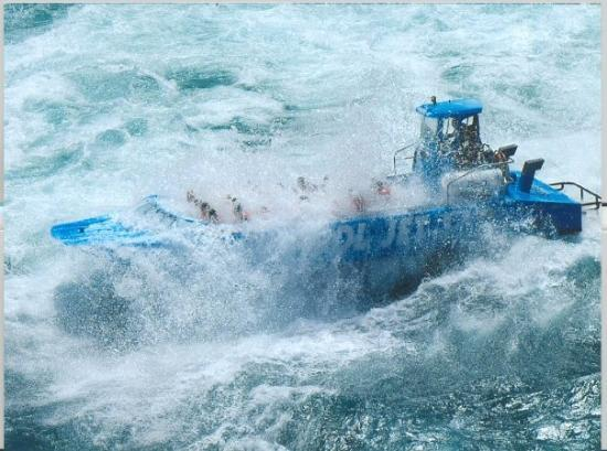 Whirlpool Jet Boat Tours: I wasn't joking when I said we were wet the whole trip!  This is our boat.  That's me in the 5th