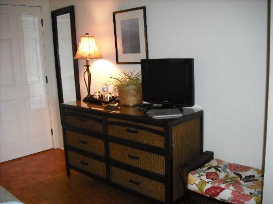 dresser opposite the bed