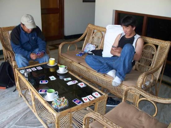 Ti-se Guest House: I am teaching Brother Namgyal, and my Sangyee how to play Skip O. It was fun and when we played