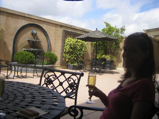 French Quarter Inn: The sparkling wine toast in their outside dining area