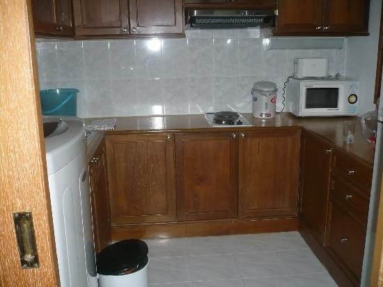 CNC Residence: kitchen with washer