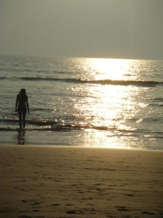 Calangute, India: sexy photo of sarah walking into the sunset