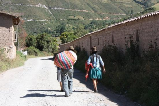 Urubamba, Peru: Andean family on their way to town.  Nearly everyone walks or takes overcrowded taxi vans.