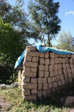 Urubamba, Peru: Adobe bricks waiting to be made into a fence, house or other structure.