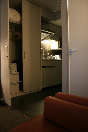 Citadines Shinjuku Tokyo: Storage between study are and kitchenette (from chair)