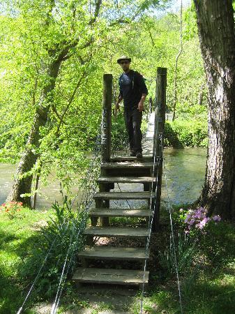 Riverside Escapes: Mike crossing the suspension bridge