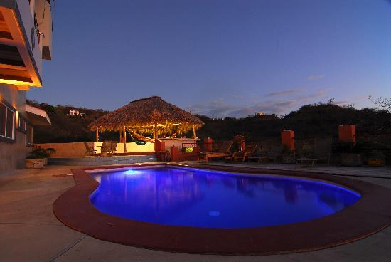 Casa Del Soul: pool & palapa at night