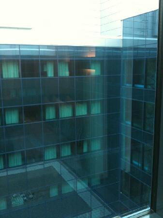 Hilton Helsinki Airport: Somewhat restricted view outside (sorry about bad iPhone image quality)