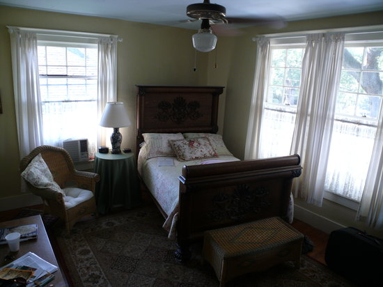 Estorge-Norton House: Bedroom with rule card  on bed