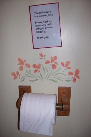 "The Wilderness Inn Bed and Breakfast: This is a sign in the bathroom of our bed and breakfast over the TP. It reads: ""The toilet has a"
