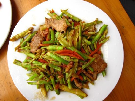 JinTian Guest House: Pork with bamboo shoots picked by Joe on our hike from the bus drop-off to the hotel. Yum...