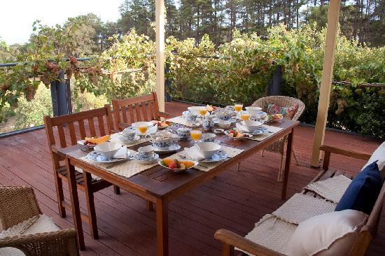 The Blue Grape Vineyard Accommodation: Breakfast on the deck