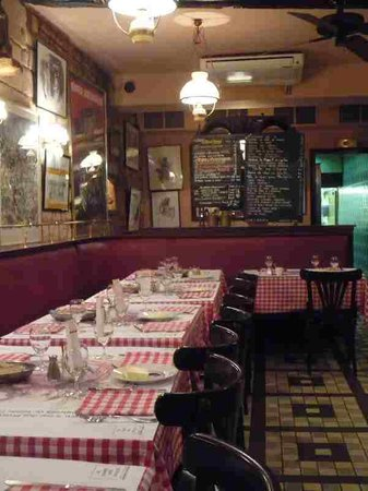 Chez Denise: Tables lined up and menu on chalkboard