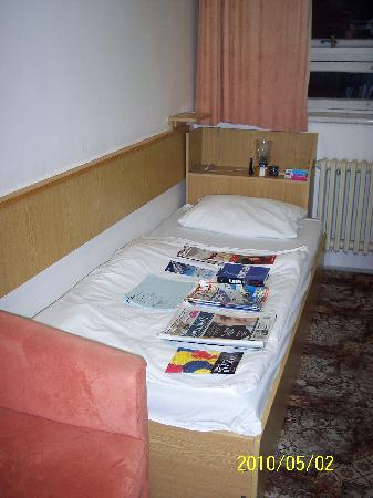Hotel Stadion: View of a bed and surrounds with my clutter