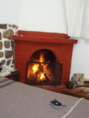 El Andariego: Room 103 fireplace