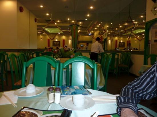 Whole Vegetarian Restaurant : Man setting up