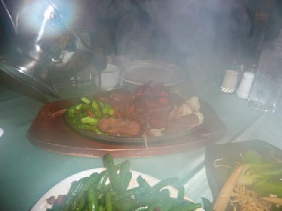 "Whole Vegetarian Restaurant : Sizzing vegetarian ""steak"" with pepper sauce"