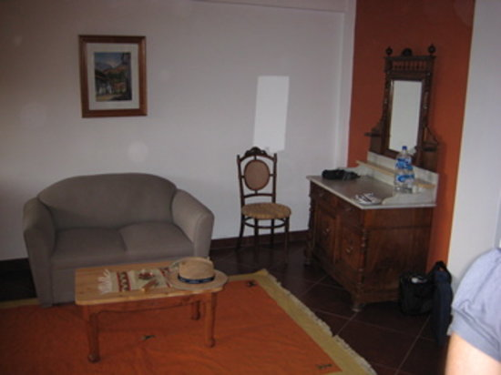 San Sebastian Hotel Boutique: the couch opposite the very comfortable bed