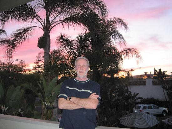 La Avenida Inn: My hubby on our balcony at sunset