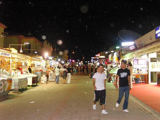 Club Belcekiz Beach Hotel: View up the main street at night