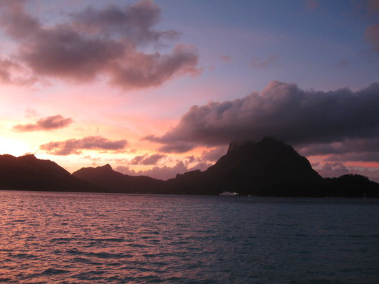 Bora Bora Pearl Beach Resort & Spa: Sunrise view from our bungalow. Worth getting up for!