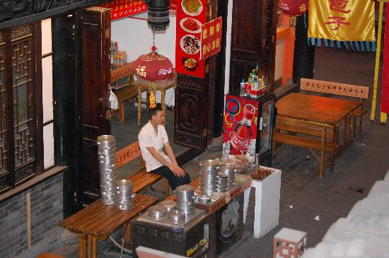 BuddhaZen Hotel : view from my balcony of a vendor selling steamed buns